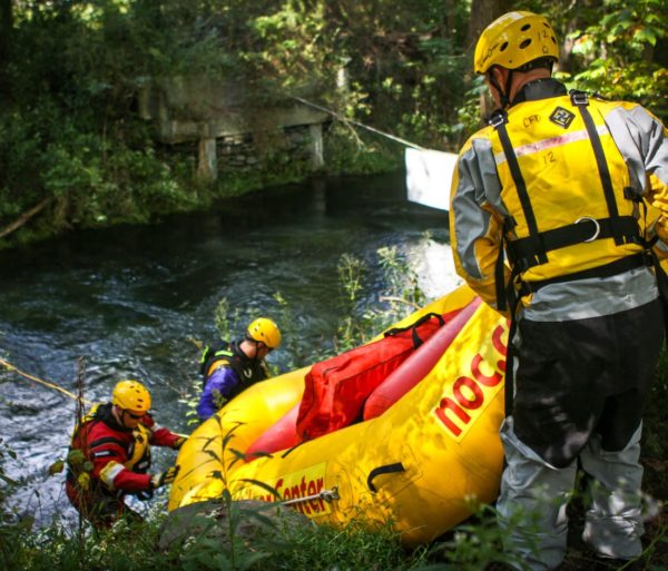 Guides pulling raft out of river during the ACA Instructor Update course