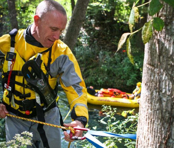 Learning to tie throw rope to a tree during the ACA Instructor Update course