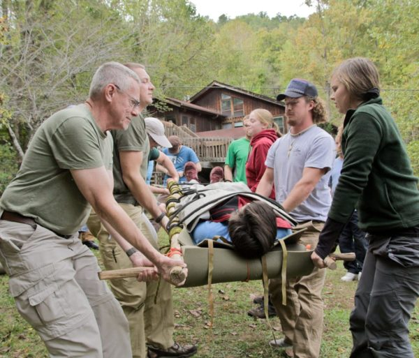 Carrying a person on a stretcher during the Advanced Wilderness First Aid (AWFA) Certification Course