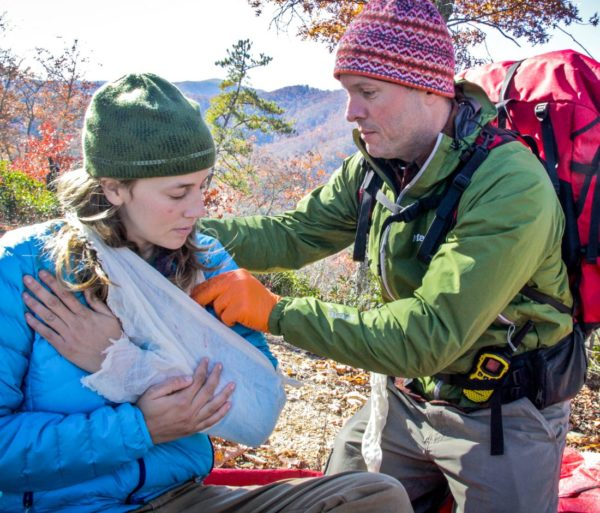Wrapping a girls arm during the Advanced Wilderness First Aid (AWFA) Certification Course