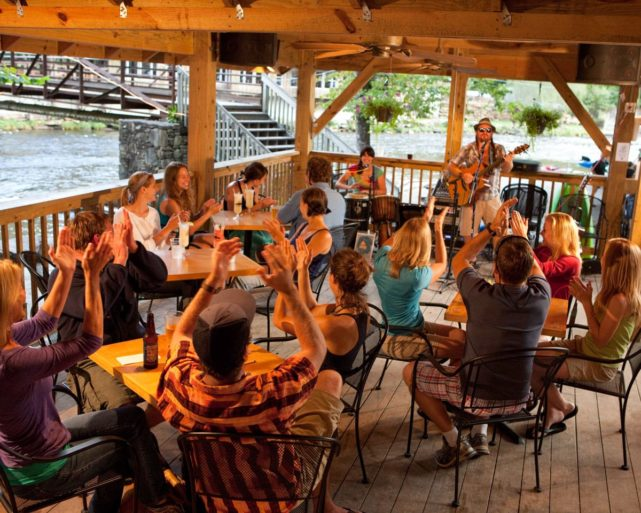 Diners listening to live music at Big Wesser Riverside Pub