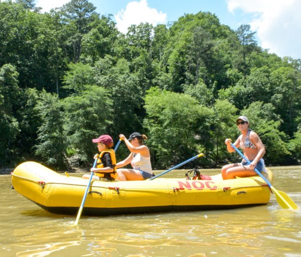Guests in a yellow raft on the Chattahoochee River Raft Rentals - Roswell trip