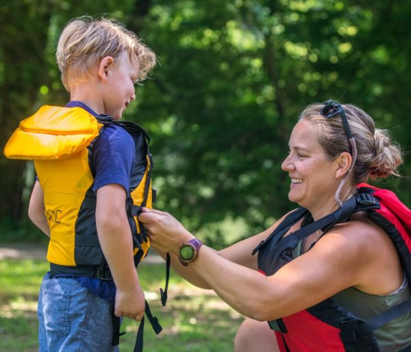 Mother and son buckling a life jacket on the Chattahoochee River Tubing – Roswell trip