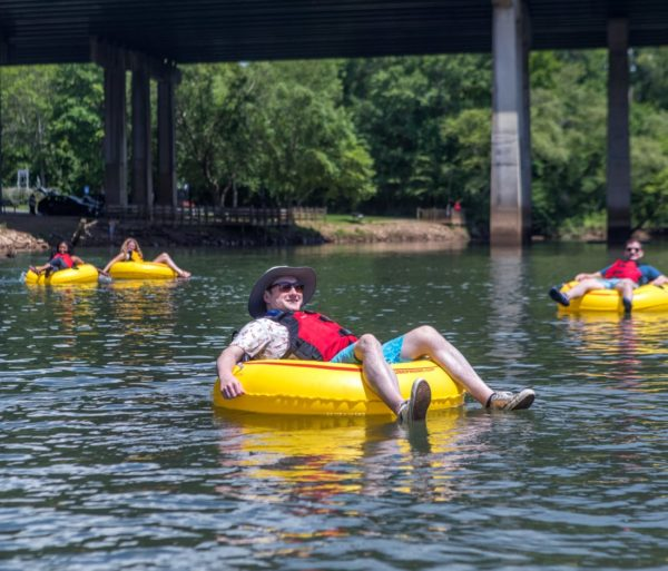 Man relaxing on a tube on the Chattahoochee River Tubing – Roswell trip