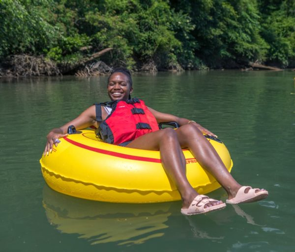 Girl relaxing on a tube on the Chattahoochee River Tubing – Roswell trip