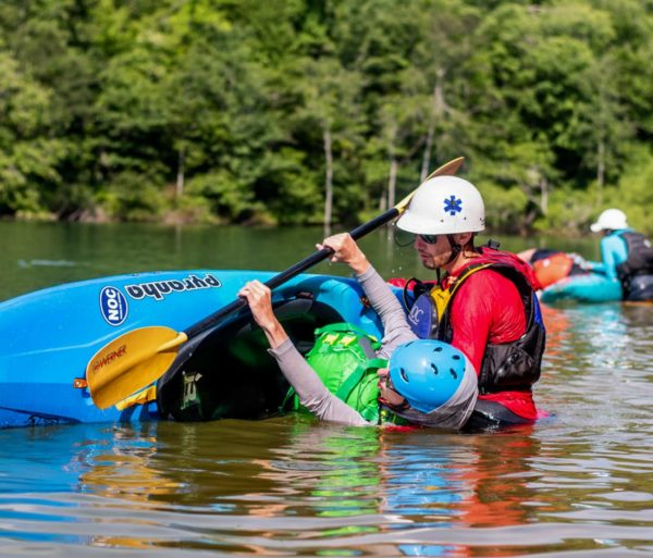 Learning how to roll a kayak on the Nantahala River- Intro to Whitewater Kayaking Trip