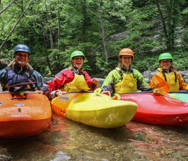 Four guests in kayaks on the Chattachoochee River- Intro to Whitewater Kayaking Trip