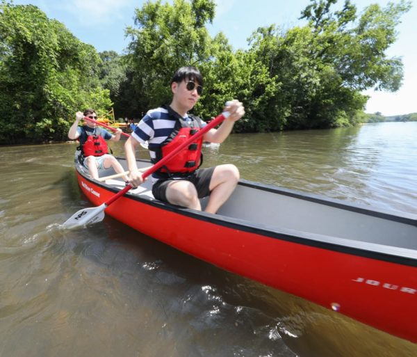 Two young men canoeing on the Chattahoochee River Canoe Rentals – Roswell trip