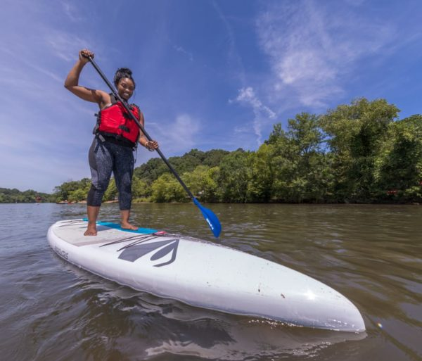 Woman stand up paddleboarding on the Chattahoochee River Stand Up Paddleboard Rentals (SUP) – Roswell trip