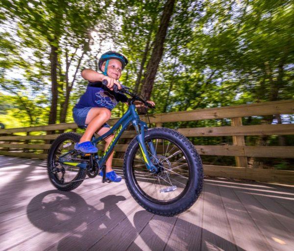 Young boy biking on the Chattahoochee River Bike Rentals – Roswell trip