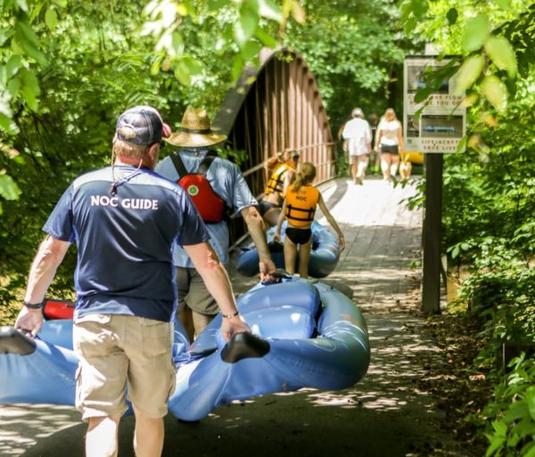 NOC guide carrying inflatable duckies on the Chattahoochee River Inflatable Kayak/Ducky Rentals - Metro trip