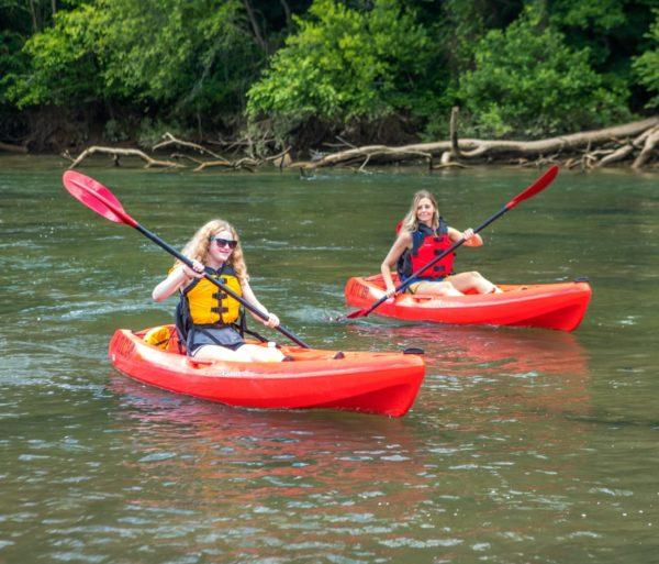 Girls on sit on top kayaks on the chattahoochee river