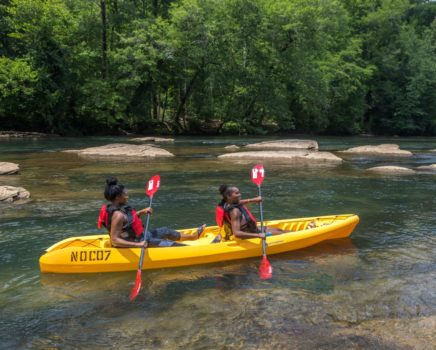 Girls on sit on top kayaks on the chattahoochee river