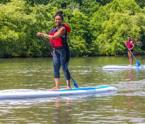 Woman stand up paddle boarding