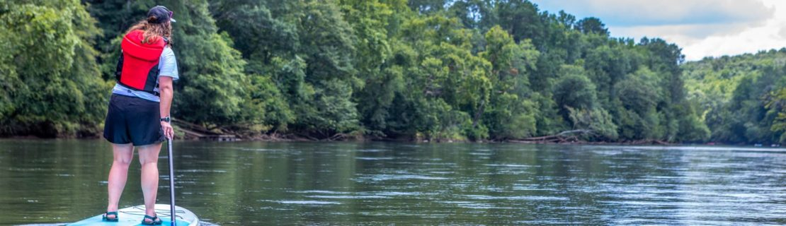 Woman stand up paddleboarding on the Chattahoocee river