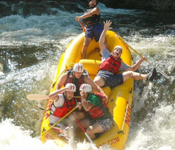 Guests going head first into a rapid on the Chattooga River Rafting: Section III (with Lunch) trip