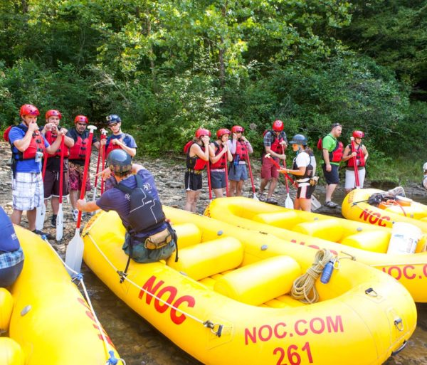 Guide showing rafting tips to guests on the Chattooga River Rafting: Section III (with Lunch) trip