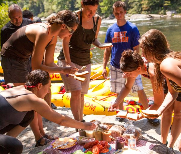 Guests eating lunch on the Chattooga River Rafting: Section III (with Lunch) trip