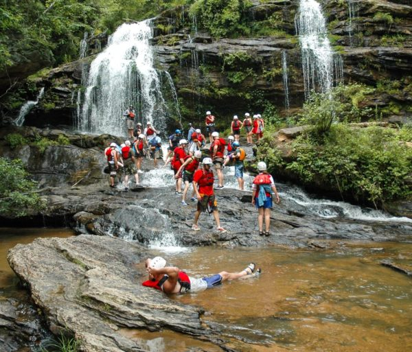 Guests relaxing by a Longcreek Falls on the Chattooga River Rafting: Section IV (with Lunch) trip