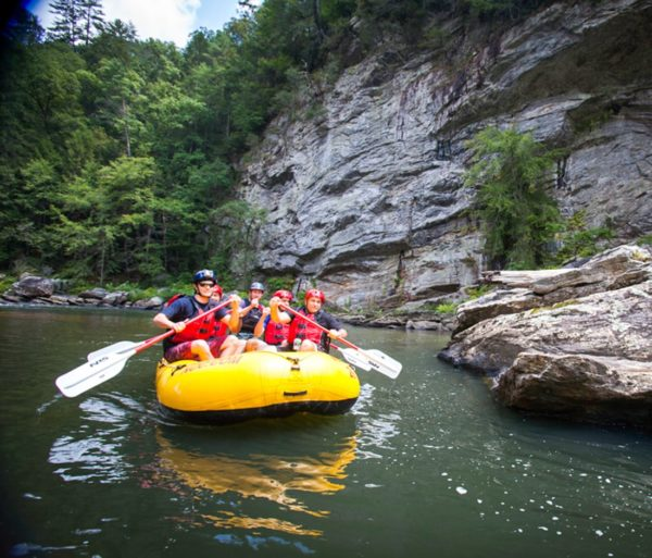 Yellow raft floating on the river on the Chattooga River Rafting: Section IV (with Lunch) trip