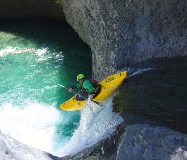 Guest kayaking down a waterfall on the Chile trip