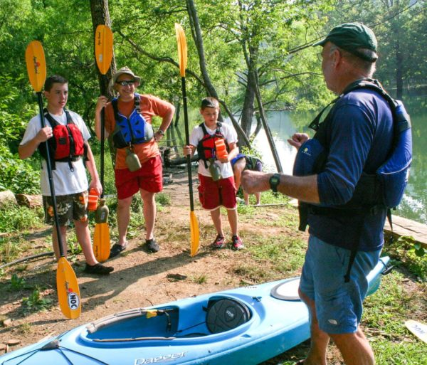 Staff giving instruction while on the Guided Fontana Lake Tour trip