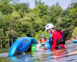 Guest learning to roll a kayak during the Introduction to Whitewater Kayaking Course