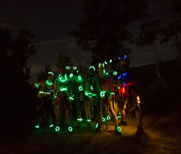 People wearing lights on the Moonlight Mountaintop Zip Line Tour trip