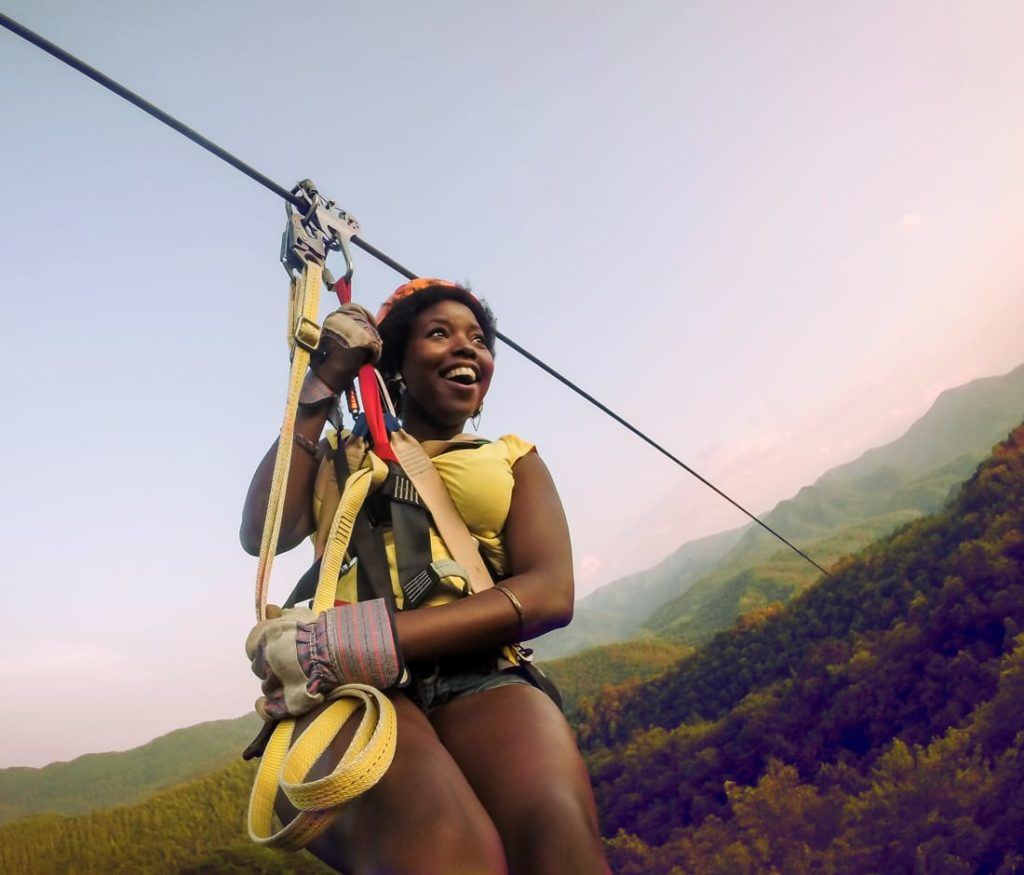 Guest on zip line on the Mountaintop Zip Line Tour