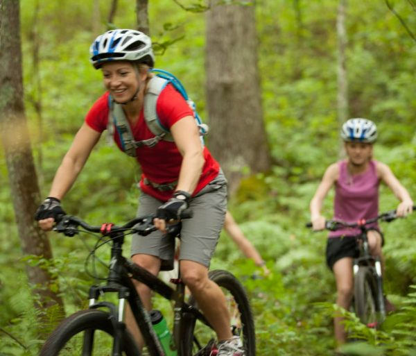 Guests biking in North Carolina on the Nantahala Adventure Pass trip