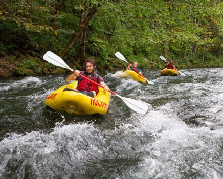 Guests kayaking in North Carolina on the Nantahala Adventure Pass trip