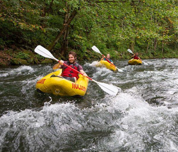 Guests kayaking in North Carolina on the Nantahala Adventure Pass trip