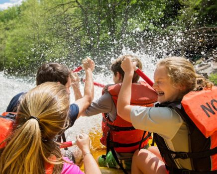 Girls getting splashed while rafting on the Nantahala River Rafting: Fully-Guided in North Carolina trip