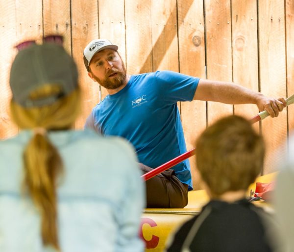 Staff teaching guests safety tips on the Nantahala River Rafting: Guided Duck Trip