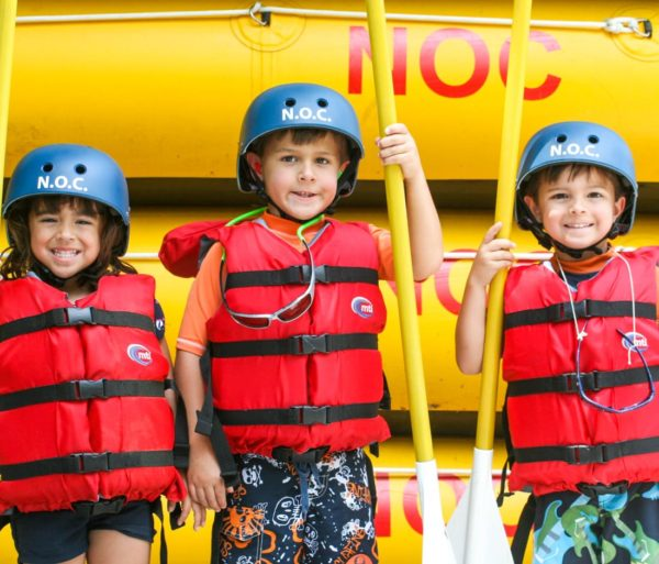Three young rafters on the Pigeon River Rafting: Lower Pigeon Gorge trip