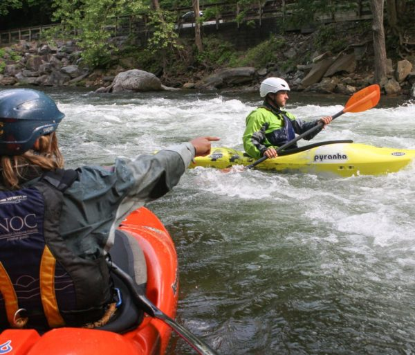 Instructor pointing to where guest should kayak on the Private Canoe and Kayak Instruction course