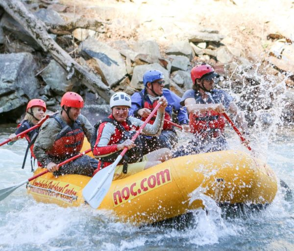 Rafting through rapids during Raft Guide School