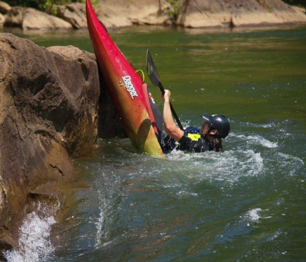 Kayaker doing a trick while on the Slicey Boat Clinic: Ocoee River