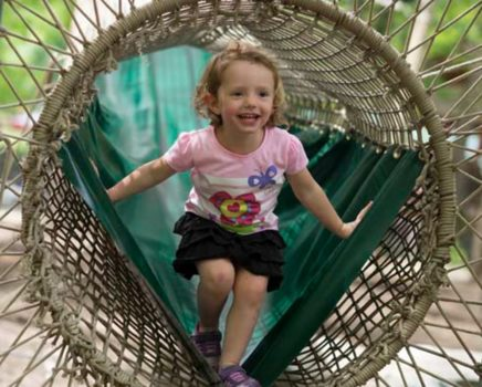 Girl playing on the Treetop Adventure Nets