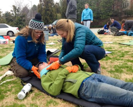 Learning how to wrap an injury during the Wilderness First Aid (WFA) Certification Course – Atlanta