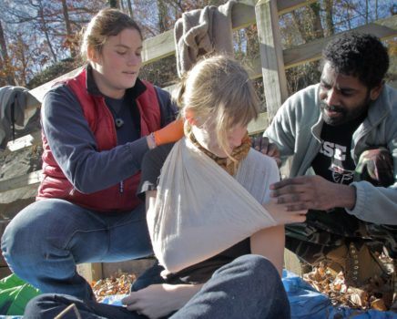 Wrapping an arm during the Wilderness First Aid (WFA) Certification Course - Chattanooga