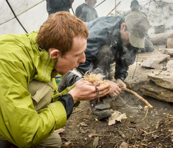 Learning how to make a campfire during the Wilderness Survival course
