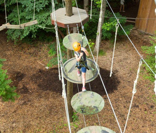 Child on the Zip Line Adventure Park
