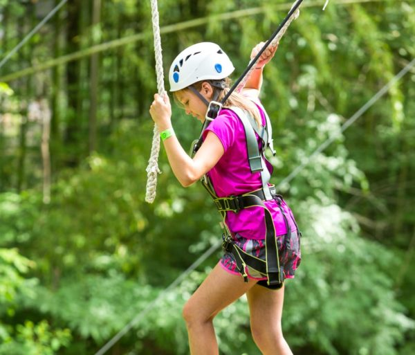 Girl crossing a section on the Zip Line Adventure Park