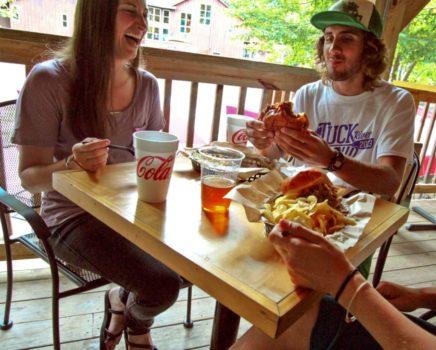 people enjoying food at Big Wesser Riverside Pub