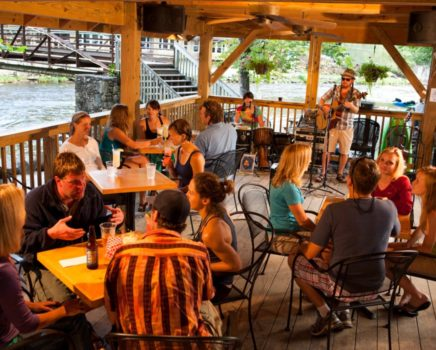 people enjoying music and food at Big Wesser Riverside Pub