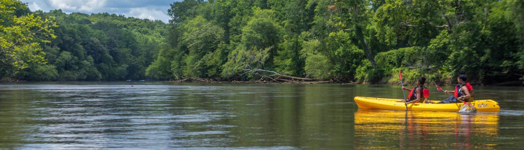 Two girls kayaking in Chattahoocee River
