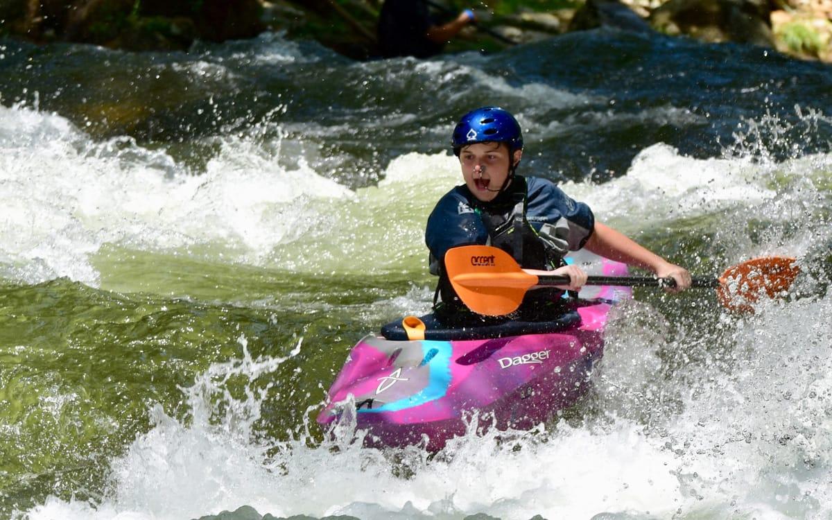 teen kayaking at a Advanced Teen Travel Camp