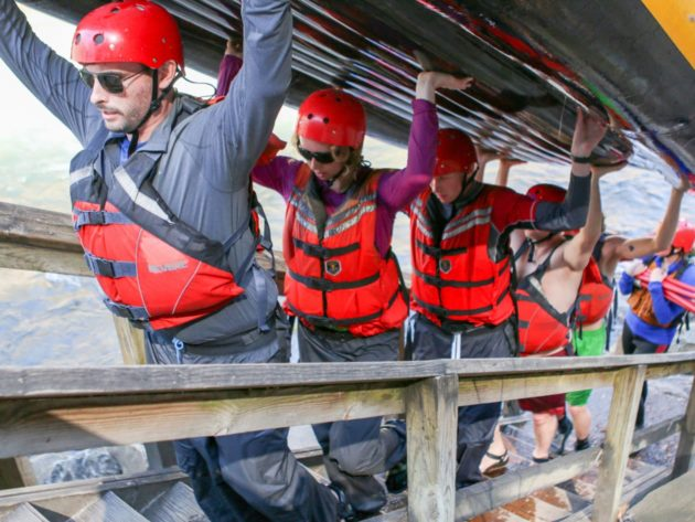 Carrying a raft up a staircase during Raft Guide School