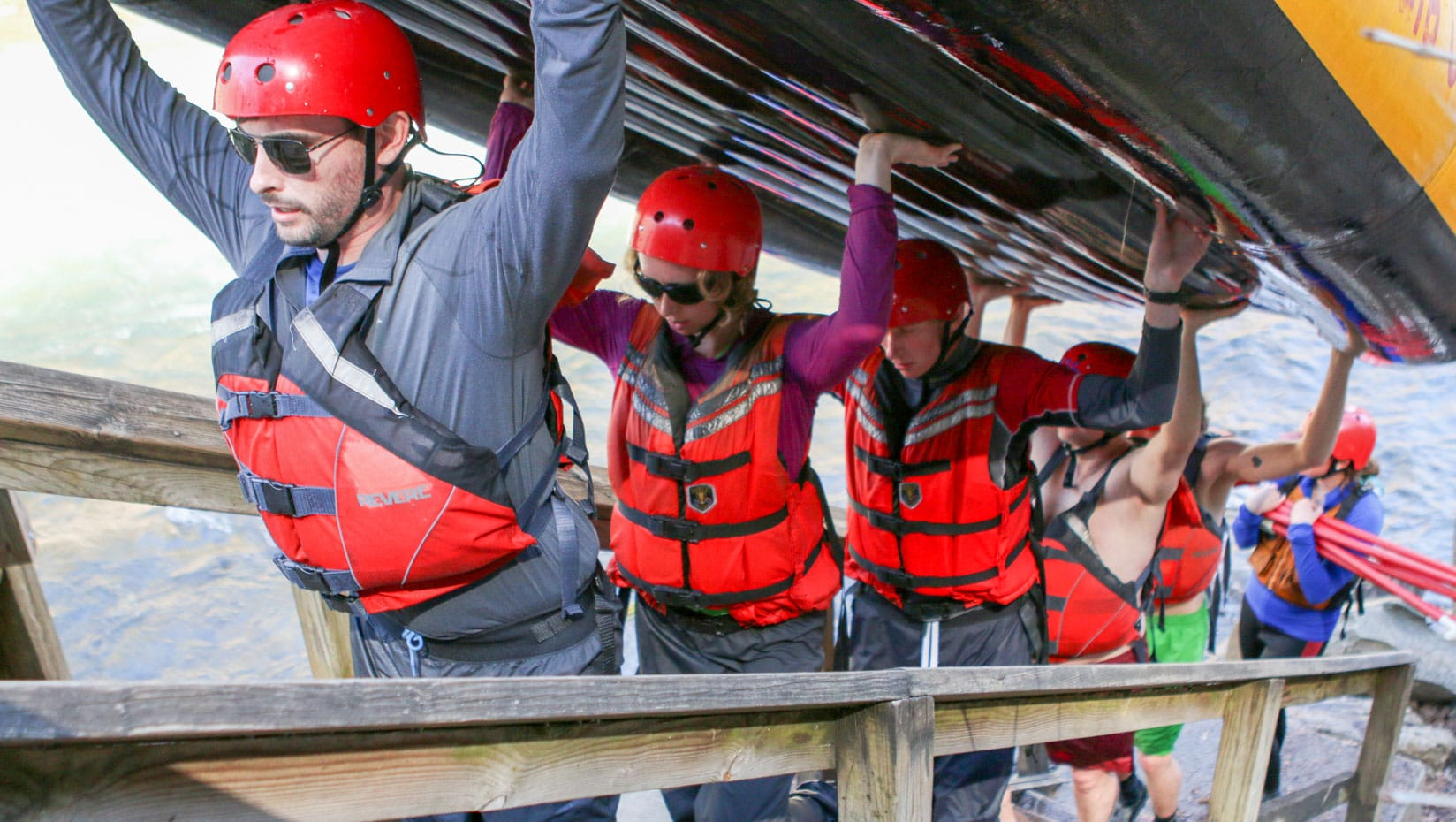 Carrying a boat up stairs during raft guide school
